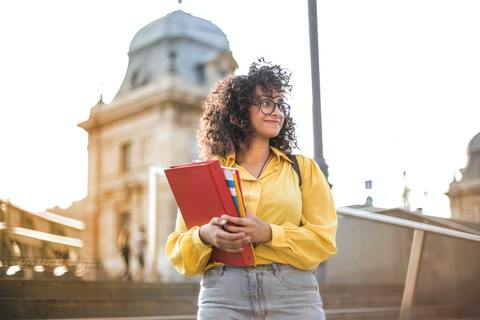 female student holding book
